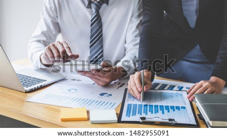Professional Business partner discussing ideas planning and presentation project at meeting working and analysis at workspace, financial and investment concept, collaborative teamwork analyze data. #1482955091