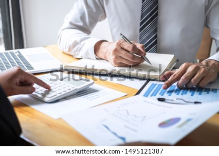 Professional Business partner discussing ideas planning and presentation project at meeting working and analysis at workspace, financial and investment concept, collaborative teamwork analyze data. #1495121387