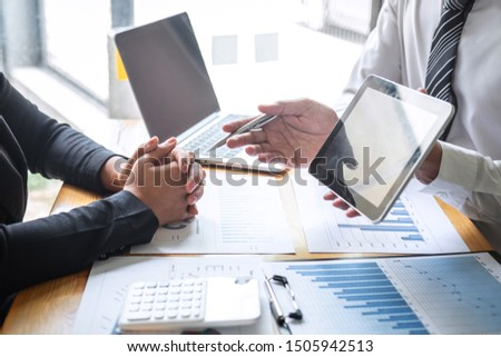 Professional Business partner discussing ideas planning and presentation project at meeting working and analysis at workspace, financial and investment concept, collaborative teamwork analyze data. #1505942513