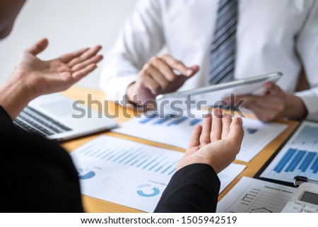 Professional Business partner discussing ideas planning and presentation project at meeting working and analysis at workspace, financial and investment concept, collaborative teamwork analyze data. #1505942519