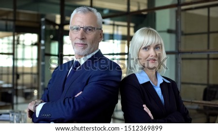 Professional business people looking camera folded arms, professionalism