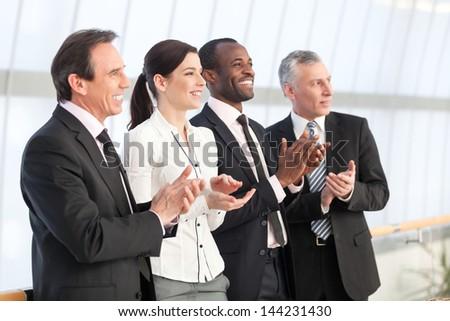 Professional business team applauding