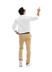 Professional business trainer pointing on something, white background