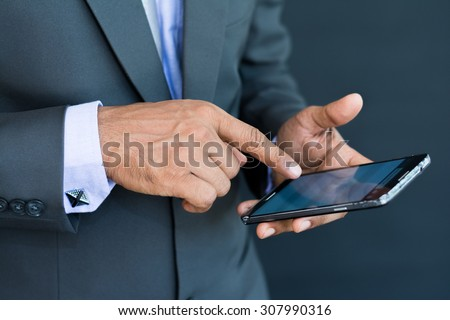 Professional businessman using a smart mobile phone #307990316