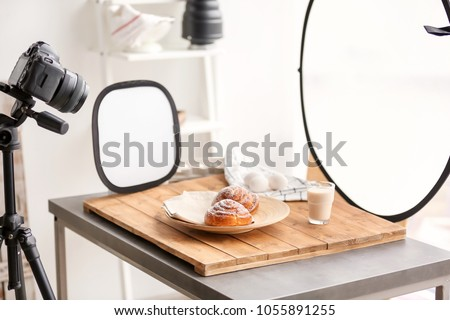 Professional camera on tripod and food composition in photo studio