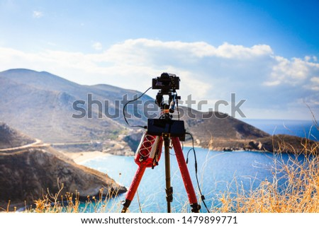Professional camera taking picture film video of seascape with mountains. Greece Peloponnese Mani Peninsula. Travel concept.