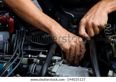 Professional car mechanic, auto repair concept.