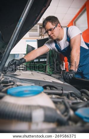 Professional car mechanic working in auto repair service #269586371