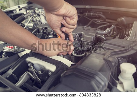 Professional car mechanic working in auto repair service  #604835828