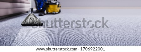 Professional Carpet Cleaning Service. Janitor Using Vacuum Cleaner Stockfoto ©
