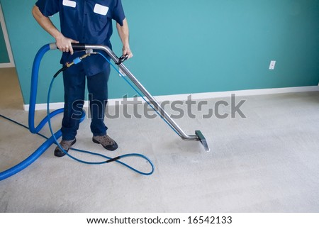 Professional Carpet Steam Cleaner Vacuuming a Home