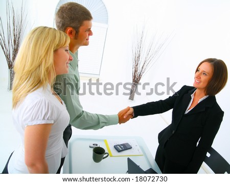 professional caucasian couple seal a deal with broker in purchasing a house