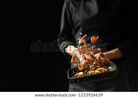 Professional chef cooked shrimp. Culinary seafood and food on a dark background. Photo of the hotel. Horizontal view.