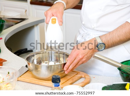 professional chef hands with mixer