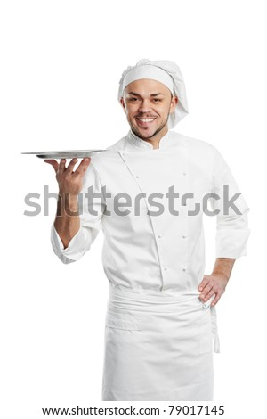 professional chef in white uniform and hat holding empty metal tray on fingers isolated
