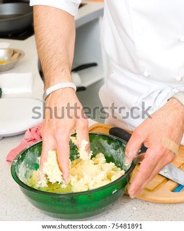 professional chef making dough