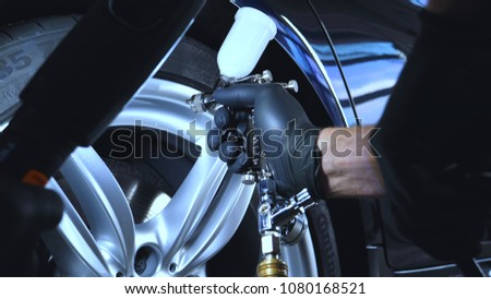 Professional coating of ceramic wheels and rubber, spray gun for painting, car service, shop, washing. #1080168521