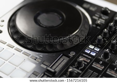 Professional concert dj turntables player device with sound mixer panel and jog wheel.Club disc jockey stage equipment for playing music on party.Digital turn table deck for nightclub