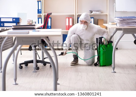 Professional contractor doing pest control at office