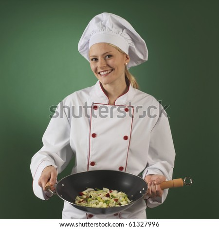 professional cook on green background one woman, she is a professional cook in uniform