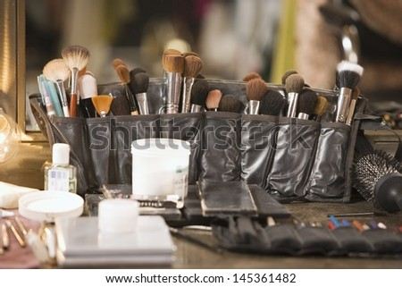 Professional cosmetics brushes on dressing table
