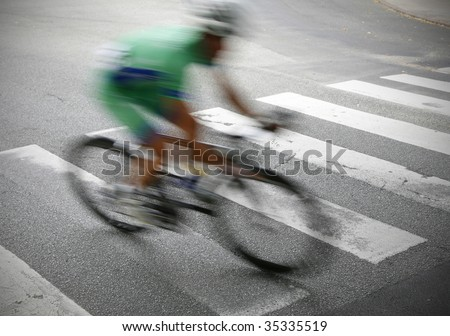 Professional cyclist rushing by just before the finishing line in a great Danish race.