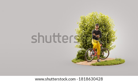 Professional cyclist standing at his mountain bike outdoors on sunny day. Cycling concept. Unusual 3d illustration