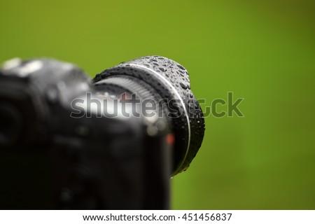 professional digital photo camera in the rain