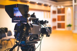 Professional digital video camera in studio