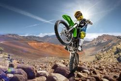 Professional dirt bike rider doing wheely