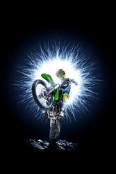 Professional dirt bike rider isolated on black background