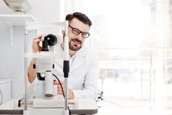 Professional distinguished eyesight specialist at work