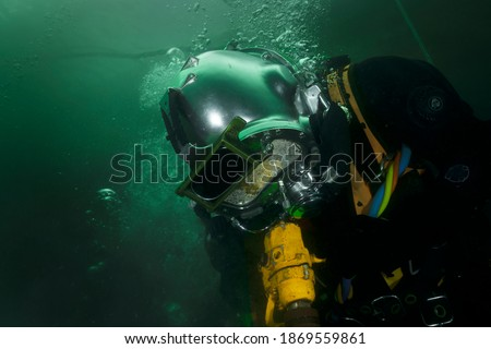 professional diver working underwater with pneumatic tools Photo stock ©