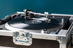 Professional DJ Turntable in Flightcase Playing Record