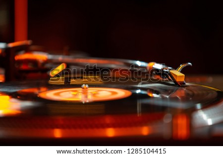Professional dj turntable with vinyl record disc.Hip hop djs setup on concert stage in music hall.Disc jockey setuo for party in night club.Scratch and remix tracks with high quality turn table player