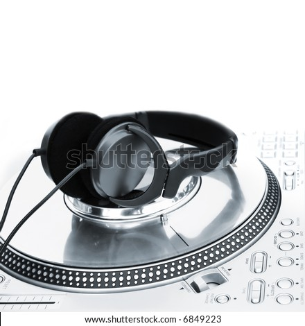 Professional DJ Vinyl Player with green Headphones on it