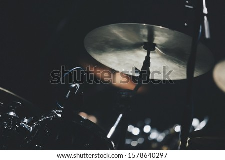 Professional drum kit on stage in night club.Drummer musical instruments in close up.Play drums on rock concert in music hall