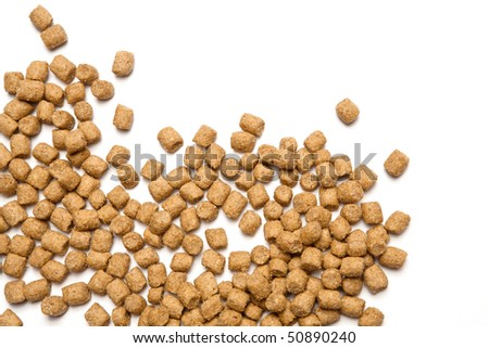 Professional dry pet food spread out on white background.