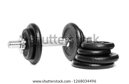 Professional dumbbell and weight plates on white background. Sporting equipment