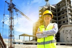 Professional engineer in safety equipment at construction site