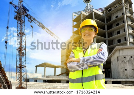 Professional engineer in safety equipment at construction site ストックフォト ©