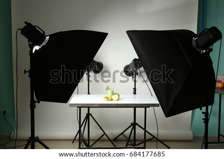 Professional equipment and juice in photo studio. Concept of food photography #684177685