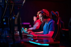 Professional esports players at an online game tournament. The cyber team plays computers and trains