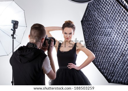 Professional fashion photography in studio with softboxes