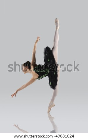 Professional female ballet dancer isolated in studio - stock photo