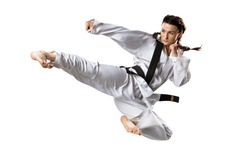 Professional female karate fighter isolated on the white background