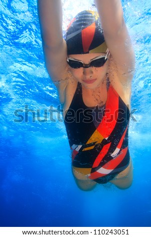 professional female sport master smiling underwater