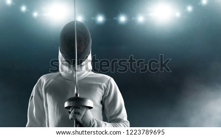 Professional fencer in fencing mask with rapier