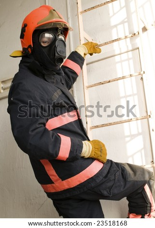 professional firefighter donning gas mask without cannister during training