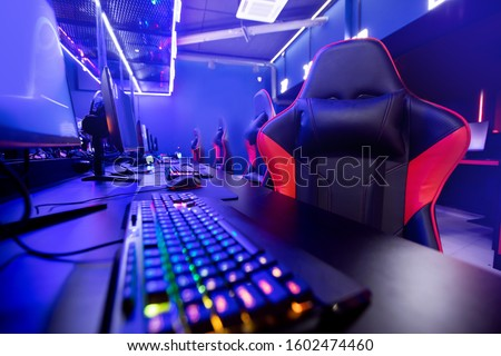 Professional gamers cafe room with powerful personal computer game chair blue color. Concept cyber sport arena.